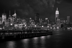 Sparkling night in New York (Michel Couprie) Tags: nyc blackandwhite bw usa newyork building architecture night clouds canon river eos newjersey noiretblanc manhattan nj sigma wideangle rivire nb sparkle esb empirestatebuilding hudson 1020mm nuages nuit hoboken gratteciel etatsunis grandangle 450d 100commentgroup