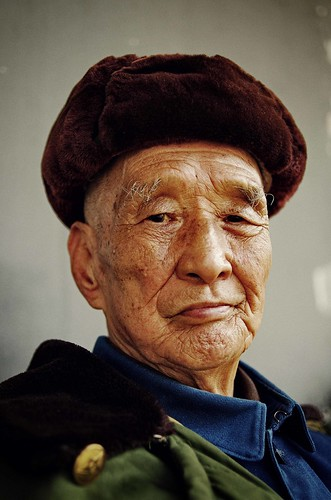 A Portrait of old man wearing army coat