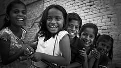 If you smile when no one else is around, you really mean it.  Shining Kids - Jaisalmer, Rajasthan, India (martinvogt) Tags: blackandwhite india white black kids blackwhite kid indien i wwwmartinvogtch