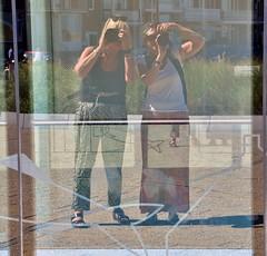 Two Flickr ladies  on the road (wilma HW61) Tags: selfie reflectie reflection spiegeling rflexion riflessione leute mensen personnes persone people katwijkaanzee zuidholland zholland nederland niederlande netherlands nikond90 holland holanda pasesbajos paesibassi paysbas europa europe t zomer summer sommer outdoor raam window glas finestra fentre fenster vetro verre glass venster wilmahw61 wilmawesterhoud mieneke dorrisd