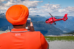 Boss (johnjackson808) Tags: bc blackcombmountain fujifilmxt1 sikh whistler helicopter mountains orange people red streetphotography turban