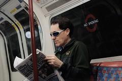 Tube man (benpadley) Tags: classicchrome fujifilm fuji xt10 shades sunglasses londonunderground uk england london commuter paper eveningstandard colour tube