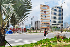 Hotel strip (Roving I) Tags: hotels hospitality tourism travel buildingsites cicilia palmtrees greenery pedestriancrossings street mothers children towers babies steel tarpaulins development expansion danang vietnam