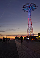 Coney Sunset V (sphaisell) Tags: newyork nuevayork coneyisland coney streetphotography street urbanphotography urban fairground themepark amusementpark funpark people bike cyclist cycle bikes cyclists sky azure firmament heavens vault celestialsphere theblue vaultofheaven wildblueyonder tower sunset dusk nightfall sundown twlight eve evening eventide gloaming closeofday crepuscularlight gloom night summer summertime vacation heat midsummer dogdays picnicdays sunnyseason holiday break celebration festival festivity recess fiesta jubilee leave liberty dayofrest fewdaysoff gonefishing longweekend redletterday blue aqua bluish cold indigo atmospheric