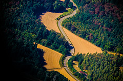 Winding (Melissa Maples) Tags: stuttgart germany europe nikon d5100   nikkor afs 18200mm f3556g 18200mmf3556g vr aerial green winding road trees forest