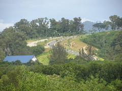 New Access Road To Sabah State Assembly Hall (thienzieyung) Tags: street morning trees terrain plants cars grass lines quiet view traffic angle cloudy perspective places hills vehicles most jungle malaysia greenery kotakinabalu access poles geography roads expensive asphalt sabah angled clearing birdseye lanes sealed thienzieyung