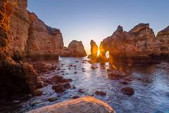 Face 2 Face (dat_sim) Tags: blue sea sky seascape portugal rock sunrise landscape coast rocks lagos algarve fusion sonnenaufgang 1022mm dri piedade exposureblending 50d efs1022mmf3545usm pontadapiedade canonefs10223545usm exposurefusion