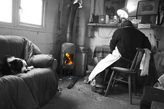 Inside the fish shack (Brother G) Tags: old sea portrait people dog white fish black beach fire sussex coast town fisherman sheep working knife east hut stove obi hastings por fishmonger monger