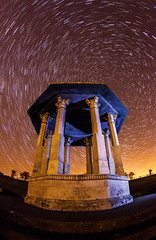 (drfugo) Tags: england sky monument stone night stars sussex brighton glow earth flash trails fisheye southdowns startrail chattri zenitar16mmf28 canon5dmkii