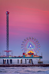 Galveston Pleasure Pier at Dusk (dfikar) Tags: park travel sunset galveston tourism beach wheel sign night america fun outdoors lights evening amusement colorful waves texas view ride fairground dusk tide shapes places ferris tourist southern spinning rides pilings recreation popular