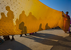 Women Drying Saris In Maha Kumbh Mela, Allahabad, India (Eric Lafforgue) Tags: india yellow festival horizontal outdoors photography asia day indie indi hinduism sari indien pilgrimage hind indi pilgrim inde hodu sangam 1300 allahabad haridwar indland  hindistan uttarpradesh indija   kumbhmela colorimage ndia hindustan indianculture  unrecognisableperson    hindia traditionalcloth  indianethnicity bhrat  indhiya bhratavarsha bhratadesha bharatadeshamu bhrrowtbaurshow  hndkastan