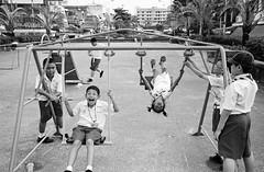 *The children at playground. (Sakulchai Sikitikul) Tags: leica bw film playground kids 35mm children kodak bessa trix streetphotography swing summicron f2 asph r2a