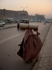 A Burqa-wearing Woman Carrying Goods on her Head, Peshawar, Pakistan (tyamashink) Tags: pakistan