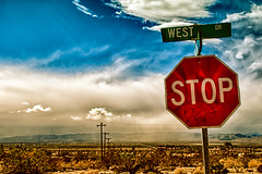 50 Steps East Is West (hbmike2000) Tags: sky mountains rock clouds nikon desert streetsign stopsign d200 hdr deserthotsprings flickrfriday hbmike2000 walk50stepsandshoot