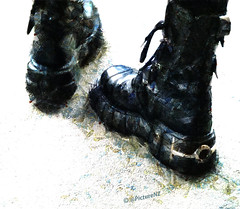 Tread Carefully (Steve Taylor (Photography)) Tags: abstract black ice leather walking army shiny boots minimalism ankle heavy tread buckles laces carefully tieup laceup