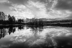 Down Auchlannochy Hill (KopeX) Tags: sky blackandwhite bw lake reflection monochrome clouds scotland unitedkingdom grain slt sigma1020 newtonstewart bwlandscape blackandwhitelandscape sigma10mm graineffect nathanreynolds monochromelandscape sonya77 nreynolds auchlannochyhill
