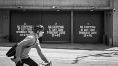 No Stopping  SFPD (b'jesus) Tags: sanfrancisco blackandwhite monochrome bike bicycle nikon cyclist garage helmet pd cycle messenger sfpd d800 garages 50mmf18 policedepartment