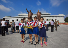 Pioneers Paying Respect To The Two Statues Of The Dear Leaders In Grand Monument Of Mansu Hill, Pyongyang, North Korea (Eric Lafforgue) Tags: school people flower color colour statue horizontal standing walking asian official women war asia day child propaganda anniversary politics father visit korea celebration forbidden kimjongil government asie former copyspace coree leadership northkorea humaninterest routine lifestyles pyongyang dprk coreadelnorte 3people capitalcities threepeople kimilsung northkorean nordkorea mansudae democraticpeoplesrepublicofkorea 북한 1011years onlywomen 北朝鮮 корея img7094 coreadelnord 조선민주주의인민공화국 mansuhill grandmonument северная insidenorthkorea 朝鮮民主主義人民共和国 rpdc βόρεια coreiadonorte เกาหลีเหนือ