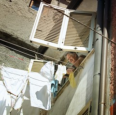 Our Italian neighbor hanging her clothes to dry on a sunny day (Bn) Tags: blue trees shadow summer vacation sky people italy sun holiday mountains green church beautiful weather relax casa fishing warm heaven paradise italia quiet locals village lima hiking candid stage peaceful highlights historic line hills clothes dolce wash laundry valley enjoy tuscany olives shutter hanging rest ravine summertime neighbour viewpoint picturesque idleness far surrounding hospitality rotary pleasant authentic piaggio discover tuscan sealevel buon buongiorno pomeriggio niente 500m neigbour bressan casoli prossimo