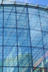 Defying gravity (Slimdaz) Tags: blue sky reflection building glass architecture pen 50mm prime birmingham steel bullring kx centon117lens
