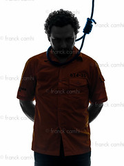 criminal man with hangman noose around the neck  silhouette (Franck Camhi) Tags: shadow portrait people white man male silhouette standing cutout person death one 1 justice adult hangman rope indoors criminal whitebackground crime hanging law studioshot convict deathpenalty adults punishment isolated sentence oneperson guilty noose caucasian execution oneman conviction hangmansnoose