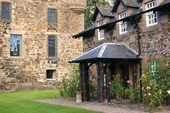 Castle (lindawood2414) Tags: castle cottage roses windows glass stone trees trunks door path grass roof tiles architecture