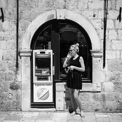 Old Town, Dubrovnik(5) (S.R.Murphy) Tags: aug2016 canon50mm18 canon6d croatia dubrovnik socialdocumentary streetphotography yawn yawning woman female lady bw flickr blackandwhite monochrome door cashmachine