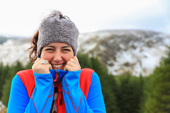 Smiling happy beautiful woman wearing colorful warm winter clothes holding her face (Semmick Photo) Tags: blue clouds fashion female green ireland mountains nature red wicklowgap woman accessories arms bright chill cold colorful cool countryside day dressed european fleece gear happy headwarmer hills hillside irish landscape layers model outdoor posing prepared protected protection season smiling snow snowy teeth trendy warmclothes white wicklow wicklowmountains winter wintertime young