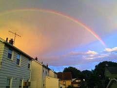 Neighborhood Rainbow (Juliana Longiotti) Tags: dramaticsky naturalphenomenon nopeople stratosphere curve sky clouds bk neighborhood urbanlandscape nightnaturalphenomenon multicolored refraction spectrum beautyinnature cloudscape rainbow