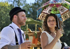 Bride and groom at the Subdued Stringband Jamboree (albertusmagnus) Tags: subduedstringbandjamboree brideandgroom summerwedding parasol tattoos naturallight outdoorwedding candid portrait candidportrait streetportrait nikkor70300mmlems nikond5000 bowlerhat
