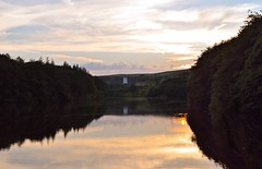 Ryburn Reservoir at Sunset (rustyruth1959) Tags: nikon nikond3200 tamron16300mm yorkshire ripponden reservoir water sunset outdoor light ryburnreservoir ryburn batingsreservoir trees reflections wall sky clouds overflow orange ripples leaves green shadows dark shade fields gold