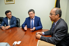 Minister without Portfolio in the Ministry of Economic Growth and Job Creation, Hon. Dr. Horace Chang, greets Chairman, China Construction American Inc., Ning Yuan