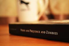 #40/365 (Rainbow Vomit) Tags: wood austen coffee paper table reading book warm dof zombie mug zombies prideandprejudiceandzombies
