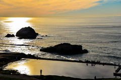 Seal Rocks and Sutro Baths along the Pacific Ocean in San Francisco California (mbell1975) Tags: ocean sf sanfrancisco california ca sunset orange sun water yellow rock landscape evening san francisco rocks unitedstates pacific dusk calif seal baths end sutro lands northern heights along