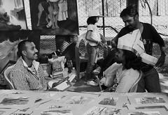 Newspaper hat (Chocolate Geek) Tags: street people blackandwhite bw mesh bangalore artists processed chitrasanthe nikond90 darktable