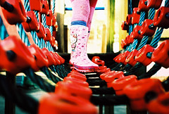 Low down on rope bridge (lomokev) Tags: pink red england feet playground children lomo lca xpro lomography crossprocessed xprocess focus brighton dof legs unitedkingdom hellokitty low ground lomolca depthoffield matilda groundlevel wellingtonboots wellies lomograph ropebridge kodakelitechrome ratseyeview matildameredith file:name=130219lomolca100xproa17 roll:name=130219lomolca100xproa