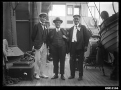 Mr John Roche (left), Mr F. J. S. Young (right) and an unidentified man onboard NAMOI, Sydney Harbour