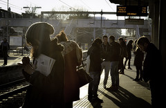 Wait on a Winter's Afternoon (Sven Loach) Tags: uk winter light england london mobile backlight contraluz newspaper cool hipsters nikon waiting afternoon shadows britain candid platform young tracks hats streetphotography rail passengers trendy scarves hip coats wooly overground phones stratford contrejour commuters tfl highburyislington d5100