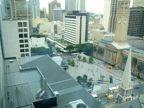 Pic: Crowds evacuated from Queen St shops by police. A man with a gun is suspected to be in Queen St Mall