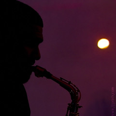 The Player of The Sun (TJ.Photography) Tags: light shadow music sun silhouette mystery purple stage spot player saxaphone musical shade mysterious tune instrumental