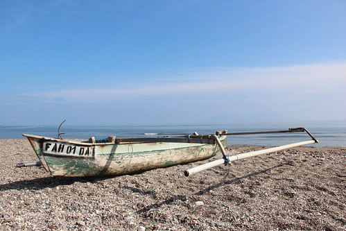 A small fishing boat on the beach in Dili, Timor-Leste. Photo by Holly Holmes, 2013.