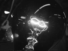 DSC06728.omi_bw (nordamerica1) Tags: lighting light blackandwhite bw white black lightbulb bulb wisconsin vintage march blackwhite glow antique antiques wi filament beloit 2013
