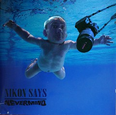 As another Canon dies at the bottom of a swimming pool, Nikon says...  [EXPLORE 24.3.13 No 12] (Zenas M) Tags: baby rivalry canon nikon grim nirvana spoof nevermind wah grotesque cdcovers werehere hereios
