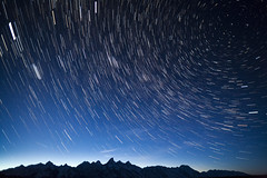 Star Trails Over the Teton Mountains (Free Roaming Photography) Tags: sky usa mountain snow mountains west night stars star nationalpark twilight trails peak western northamerica nightsky wyoming teton tetons comet grandteton meteor jacksonhole startrails darksky polaris northstar grandtetonnationalpark shootingstar panstarrs cometpanstarrs