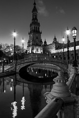 Sevilla, plaza de Espaa (Michel Couprie) Tags: plaza bridge blackandwhite bw reflection tower water architecture canon square eos evening spain tour place noiretblanc streetlamp sigma wideangle rivire nb reflet reflect 7d pont bluehour 1020mm soir espagne lampadaire plazadeespana rverbre grandangle spainsquare placedelespagne