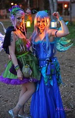 Fairies In The Village in The Evening (wyojones (Finally Back After A Month Away)) Tags: beautiful beauty look festival tattoo night nose necklace wings eyes lowlight texas expression makeup paige lips fairy faire lamps lovely fairies renaissancefestival roxy bluehair renaissance renfest maiden wench purplehair latterns girlwoman sherwoodforestfaire