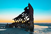 Enchanting Limbo (Buuck Photography) Tags: blue sunset abandoned oregon skeleton photography evening boat colorful alone ship stuck dusk space alien nowhere cyan surreal historic creepy spooky shipwreck forgotten elements rusted worn weathered rusting lonely oregoncoast aged wreck ghostly solitary peteriredale limbo pacificcoast battered immobilized otherworldly emptyspace enchanting vibant fortstevensstatepark buuckphotos buuckphotography