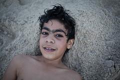 Dubai, 2013 (Marta Rybicka) Tags: street boy portrait people colour beach smile face relax eyes sand dubai head emirates martarybicka