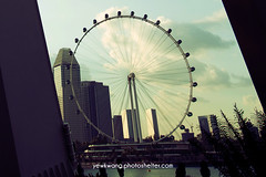 Singapore Flyers 01 (yewkwangphoto) Tags: sea cloud seascape tourism water horizontal architecture landscape singapore asia cityscape bluesky tourist tropical skyscaper commercialbuilding ferrywheel placeofinterest buildingstructure photocategory singaporeflyers yewkwang photographybyyewkwang