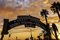 Santa Monica Pier Sign 2011 (Patrick Gregerson) Tags: 2011 california canonefs18200mmf3556is pacificocean santamonica beach clouds day outdoors outside palmtrees people pier sign sky streetlights sunset vacation canonrebelxti